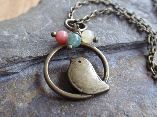 Bronze bird pendant with jade, green aventurine and yellow aragonite gemstones