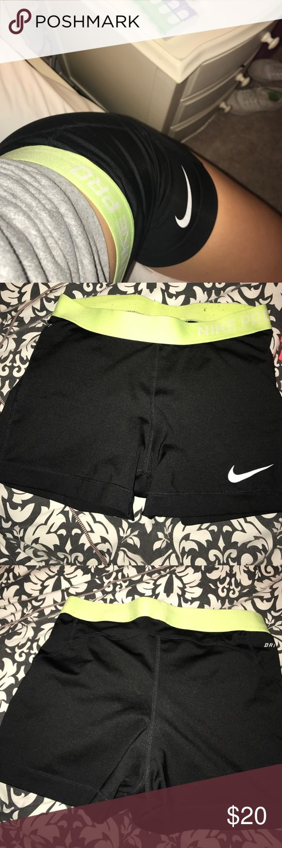 Nike Pros shorts Black NIKE pro compression shorts with a neon yellow waist band, size medium, good condition Nike Pants Track Pants & Joggers