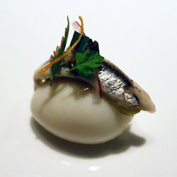 Quail egg with anchovy from Next Restaurant in Chicago, IL.