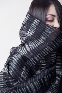 Pleated Wrap Description: I hand-dye paper-like silk organza in a somewhat traditional arashi shibori method through various ways of pleating and manipulating this silk. To this, I add layers of lines with stitching to define contrast and add weight. Dimensions: H:90.00 x W:14.00 x D:1.00 Inches