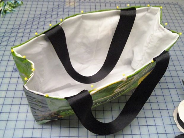 Picture of Place the lining in the bag. Using a dog food bag, this one is lined.