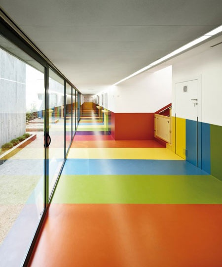 hard concrete exterior transitions to soft colorful interior