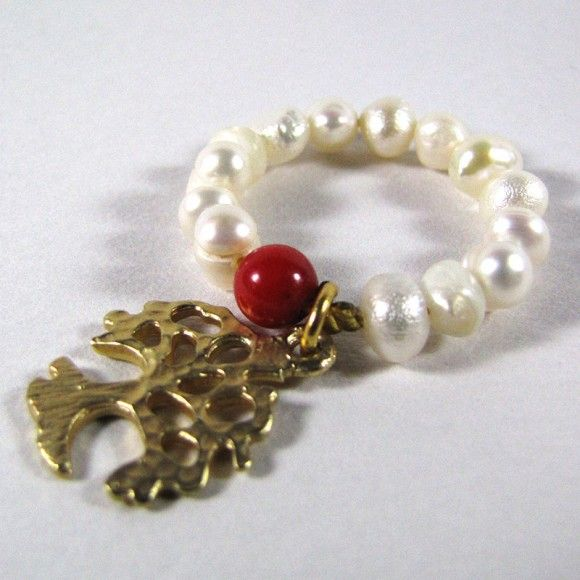 Tree ring with natural pearls, semi-precious red coral stone and golden tree element.