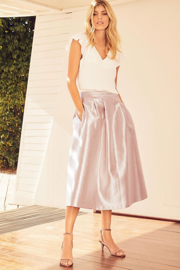 3e7a89ea7d3 A modest ruffle top wedding guest dress UK with tea length metallic skirt  and two pockets.
