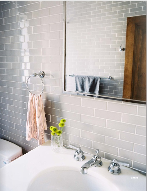 grey tile bathroom photo gray subway tile and a striped hand towel in a bathroom