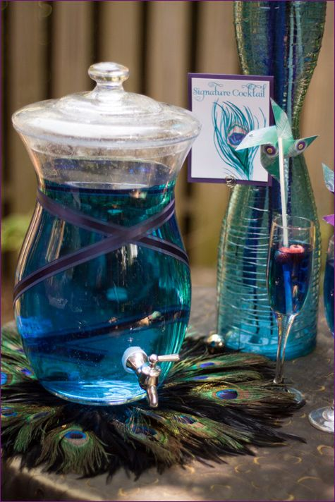 CATERING | Peacock Cocktail Punch - Signature cocktail of citrus blue Curacao for that bright blue color.