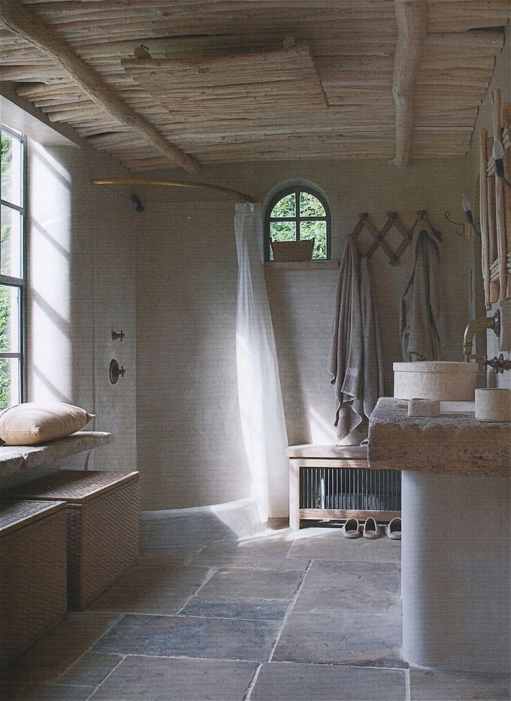 Creative ways to make modern bathrooms with the use of natural and old building materials.