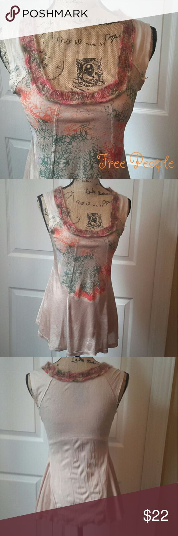 Free People Cream Crochet Tank Beautiful addition to your summer wardrobe!! Free People cream (dark cream almost tan) tank top with green, pink & orange web design on front with crocheted neckline. In overall good used condition with normal wash wear except picks and pulls near hem line (see photos #5 & 6) Measurements in photos Open to offers! Free People Tops Tank Tops