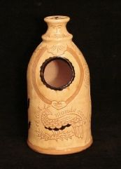 """redware salt cellar front - wheel thrown salt cellar inspired by an antique Armenian form with """"e tout le monde chante"""" (""""everyone sings"""" in French) inscription and sgraffito pattern with trees, bird, face, arms and braids, white and black slips. 13"""" H x 7"""" D. Lead-free, signed and antiqued on the unglazed surfaces. $120 - KulinaFolkArt.com"""