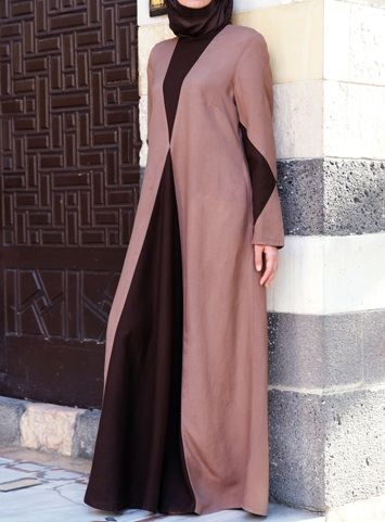 Diamond Contrast Abaya Dark Chocolate color This new bold dress from SHUKR is sure to turn heads- and all for the right reasons, of course. The cleverly colored panels in the front and back add a flash of drama while creating super easy movement and an extra modest silhouette. The diamond design on the sleeves adds cohesiveness and interest to the overall look.