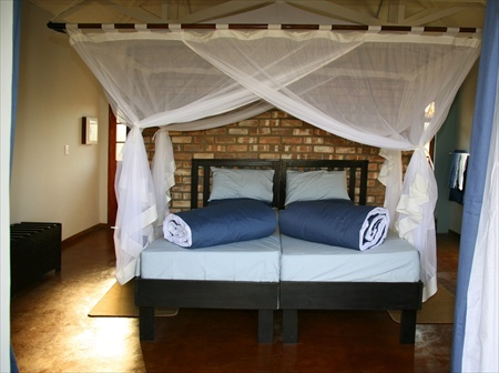 The beds in one of the guest bungalows of the Etosha Safari Lodge.