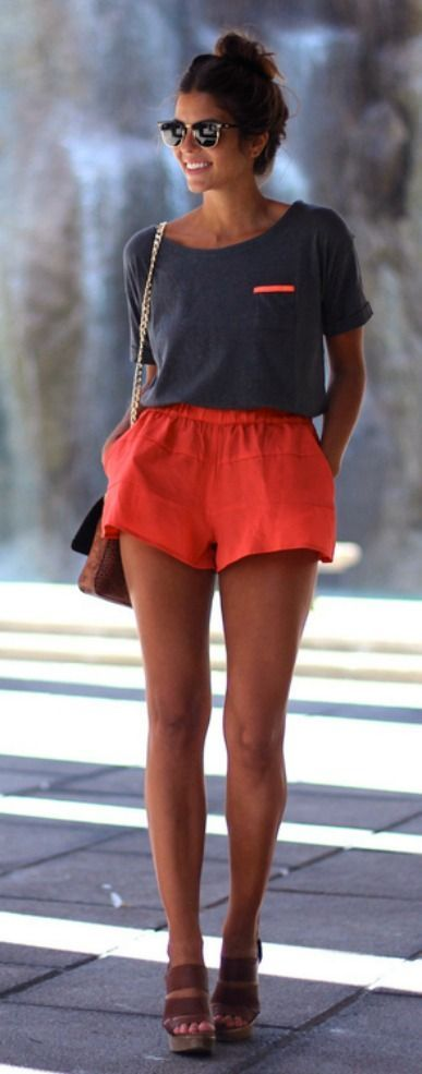 Shop this look on Lookastic:  https://lookastic.com/women/looks/crew-neck-t-shirt-shorts-wedge-sandals-crossbody-bag-sunglasses/11545  — Charcoal Crew-neck T-shirt  — Red Shorts  — Brown Leather Crossbody Bag  — Brown Leather Wedge Sandals  — Black and Gold Sunglasses