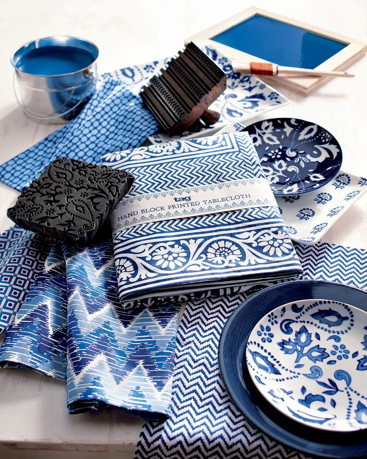 traditional block printing technique: handmade indigo textiles in blue and white, from Jaipur, India. pictured with tableware from the indigo collection