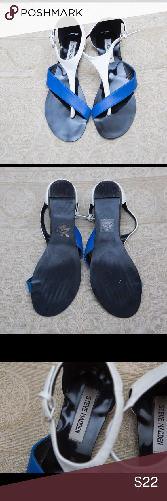 Blue/white Steve Madden flat sandals. Size 8.5 Get ready for Spring with these royal blue and white sandals with a shiny black base/sole. Clean and minimally used. Steve Madden Shoes Sandals