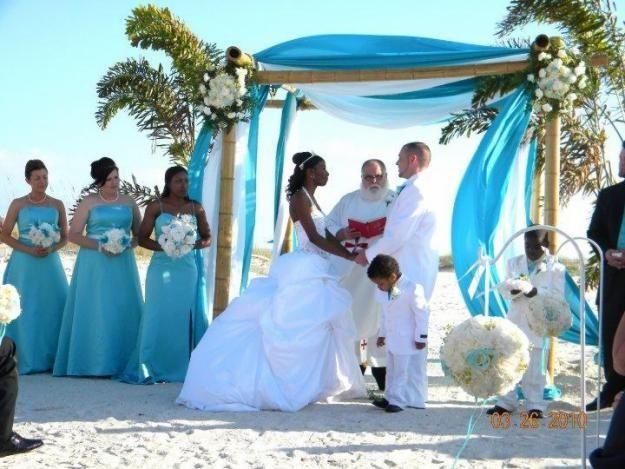 A Florida Beach Wedding Arch With The Aqua Blue Fabric