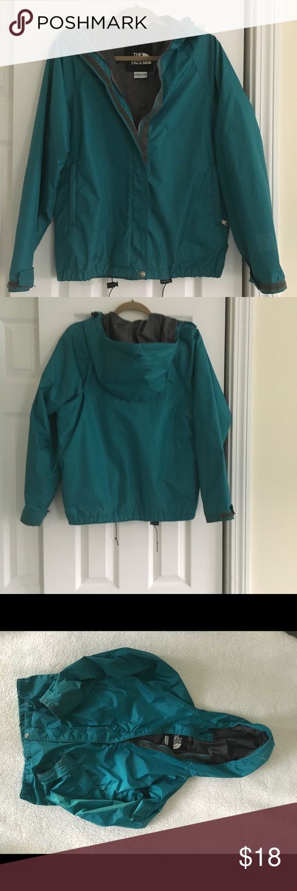 North Face WOMANS RAIN JACKET Woman's North Face rain jacket with hood. Front zip with Velcro closing. Adjustable Velcro close cuffs.  Great teal color with gray lining. The North Face Jackets & Coats