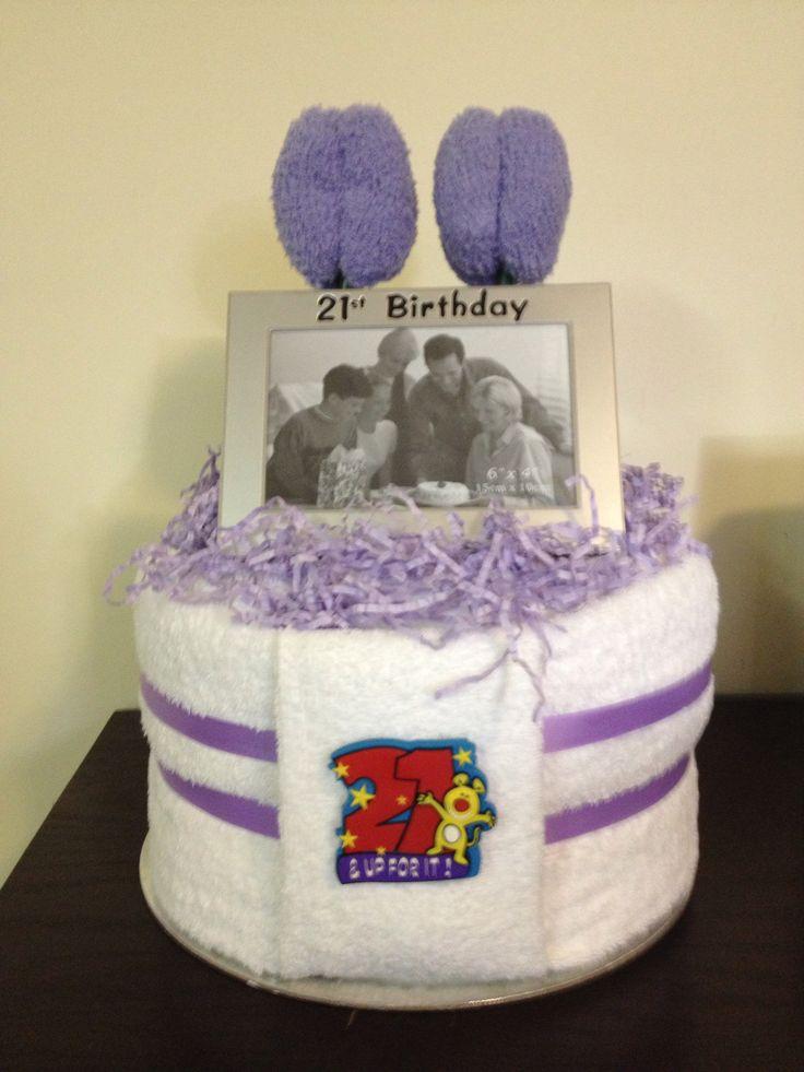 21st birthday towel cake with bedrock tulip flowers  Www.facebook.com/amandascreativecreations
