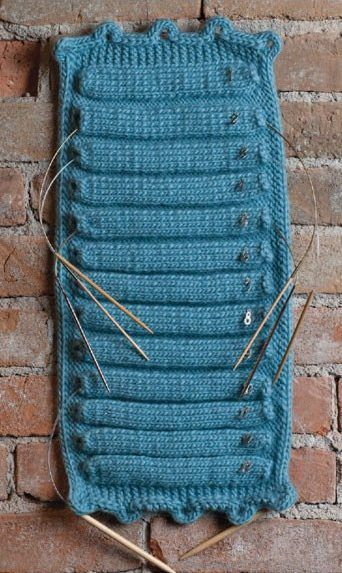 """Knitting pattern for Circular Needle Holder - Kristin Omdahl designed this ingenious organizer for your circular needles that uses simple stitches, bulky yarn, and a handy hanging loop. 8"""" long and 9"""" wide. Originally published in Interweave Knits Weekend 2011"""