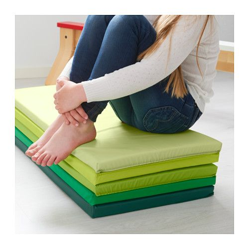 PLUFSIG Folding gym mat  - IKEA. Great for an extra seat but also to unfold and use for any physical activities.