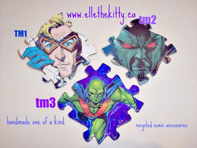 Handmade recycled media jewelry  Items are one of a kind and can be ordered as pins, magnets, pendants, zipper pulls, shoe charms and other things. They are coated with resin for durability . Animal man has been sold already.... Support indie art  www.ellethekitty.ca