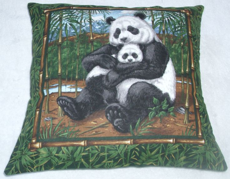 Panda nursing her cub with bamboo canes cushion by fabricitems on Etsy