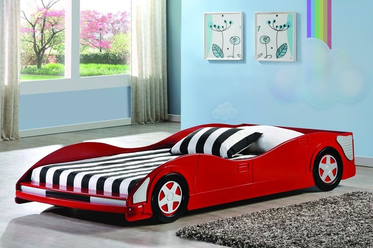 Delight your child with these adorable race car boys beds that will have your little racer excited to go to sleep every night! This twin bed has a bright red finish and eye-catching sides and carved d