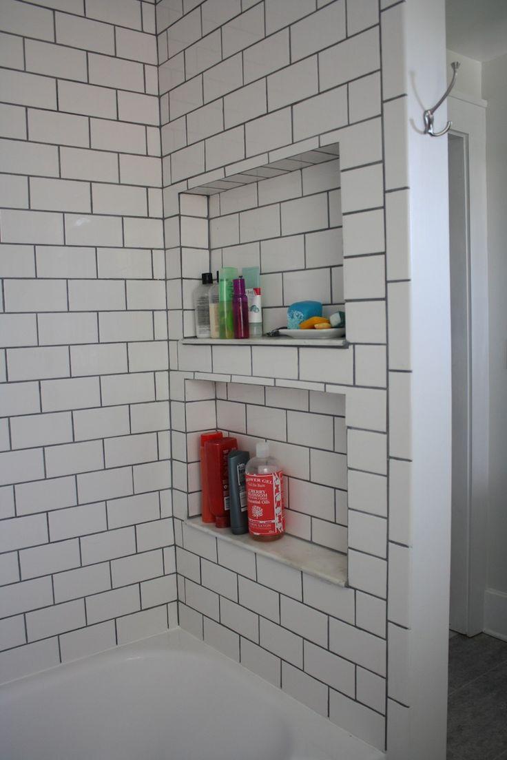 Bathroom shower storage above tub, grey grout