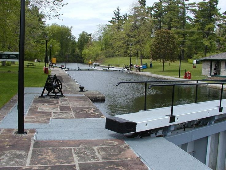 One of 47 locks on the Rideau Canal built after the War of 1812 to carry military supplies between Ottawa and Kingston. The locks are still operable, many of them using the same hand cranks as the original. It is used for recreational purposes today with camping and restroom facilities provided at most locks. ~~ 5/23/2003