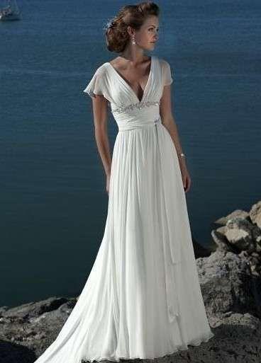 Vestidos de novia de corte imperio: Fotos de los mejores modelos - Modelo de vestido de corte imperio con escote en uve