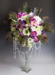 I like the skin vase and fullness up top. Not liking the feathers and flowers
