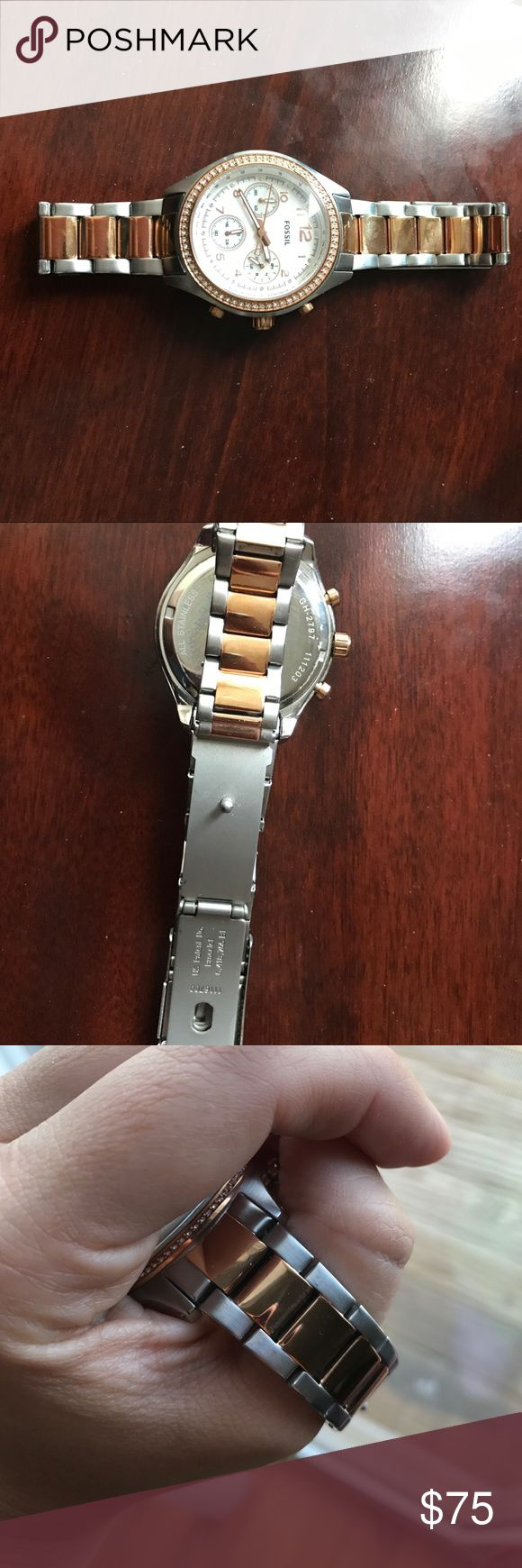 Fossil silver and rose gold watch Gently used The shiny stainless steel 10 ATM makes this timepiece a stunning addition to your wardrobe. This watch  also features a multifunction movement on a stainless steel bracelet. Fossil Accessories Watches