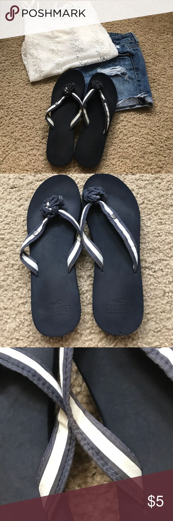 Hollister flip flops. Navy and white stripe. Slight flaws pictured above. Slight smudges on white striped. Small hole in bottom of right left shoe. Size 6/7 Hollister Shoes Sandals