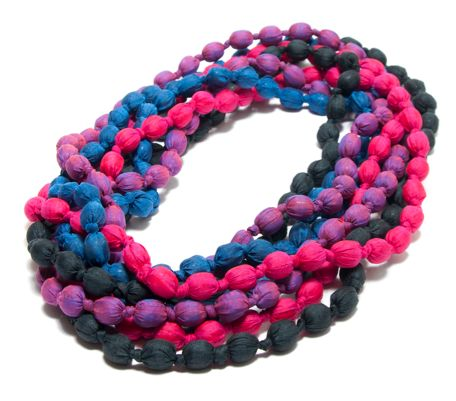 Artisans wrap individual beads in Cambodian silk and knot them together to create this unique and stylish piece of jewelry. So versatile you can wear them long or double wrapped! #cambodia #fairtrade #socent #socialbusiness #changemakers #crs #socialenterprise #neweconomy #socialgood #cause #giveback #dogood #phatricegoods