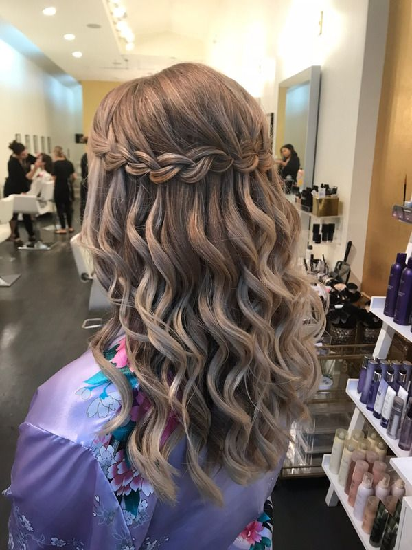 this waterfall braid with soft waves is the perfect wedding, prom, or homecoming…