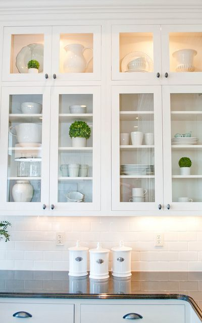 Glass front cabinets, subway tile, white