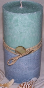Seamist & Caribbean Teakwood by Sharon Keck  - Visions of a beach cottage are evident in this candle.     The 3in X 6in round pillar candle is light blue and seafoam green. It is scented in Seamist and Carribean Teakwood. The candle is handcrafted from all natural palm wax. It is wrapped in natural raffia ribbon and accented with a stone bead. $8.00 On Artful Vision, a portion of your purchase is donated to a participating non-profit of your choice. #bath #candles