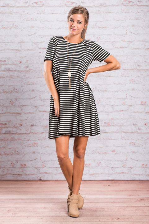 This best selling number is back and we couldn't be more excited for you! ;) An A-line dress is always a nice cut but then you add these classic stripes and you have a dress has definitely worked it's way into our hearts! The flare on this dress is so fetching! And who doesn't love a dress that looks great with boots?!