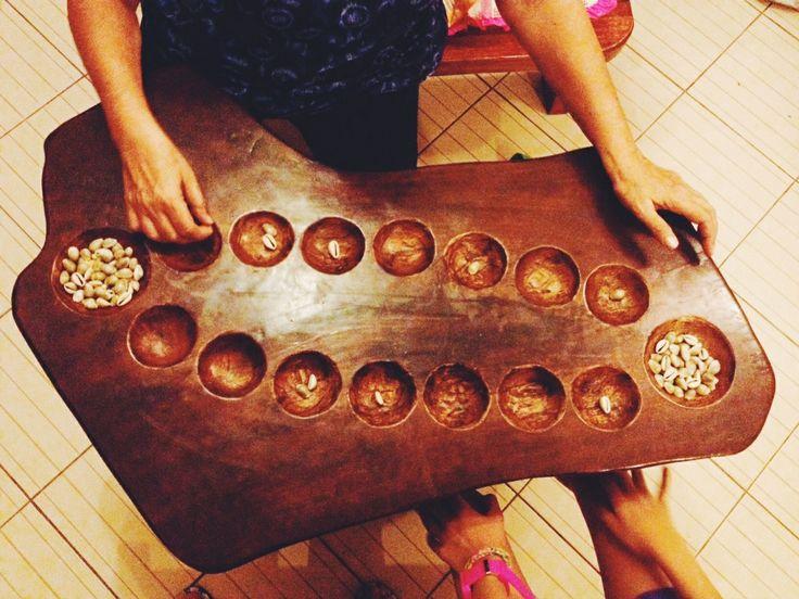 Sungka. Mancala variant of the Philippines. Sungkaan