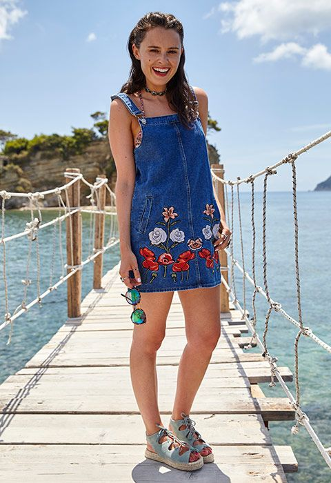 """""""The floral embroidery on this denim minidress is a new style for me, but was great to wear for an afternoon of exploring. It's perfect with a little bikini underneath and a western-style choker. It'd also really work with a fitted crop-top at sundown."""" Venetia Falconer"""