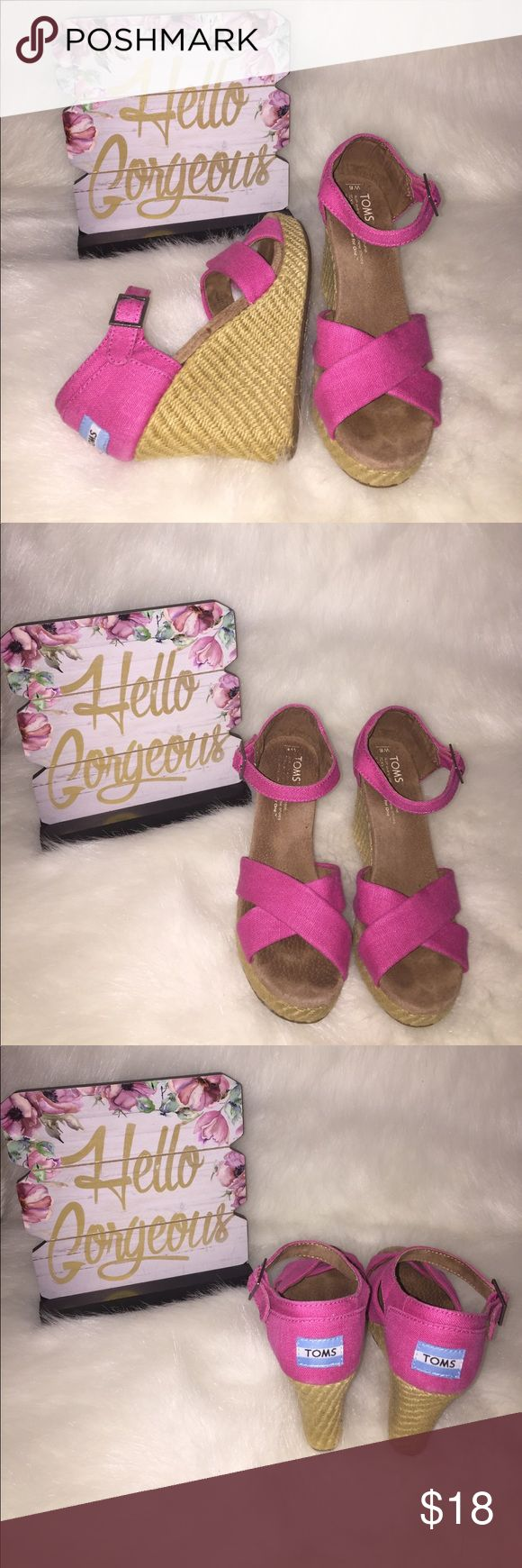 Pink TOMS wedges Super cute. Great condition. I just don't need these and they need a new home. Toms Shoes Wedges