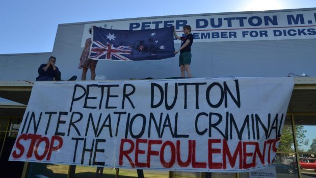 "Immigration Minister Peter Dutton has called on Bill Shorten to condemn the actions of a Labor ""idiot"" who dangerously scaled the roof of his Brisbane office."