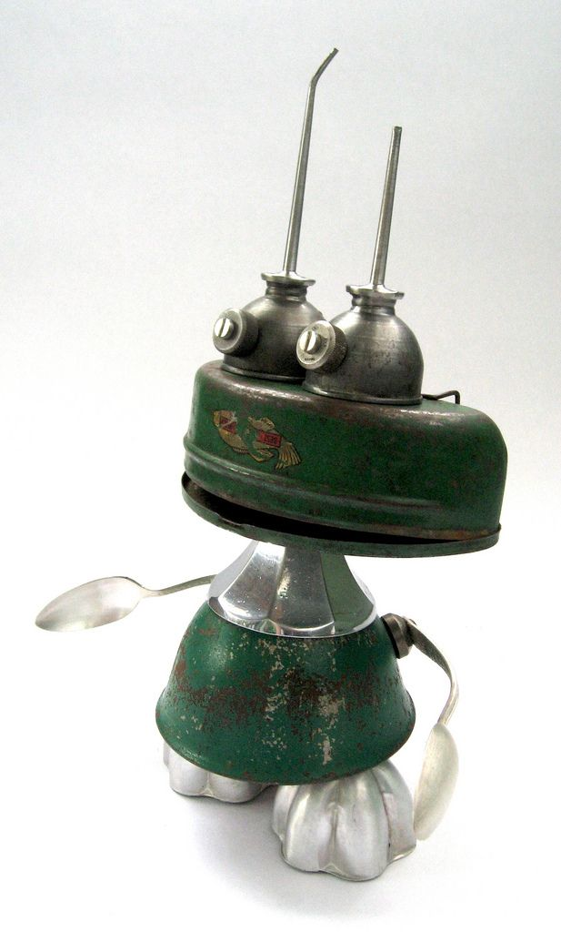 https://flic.kr/p/6TwDUe | FMG - Found Object Assemblage Robot Sculpture | Robot sculpture assembled from found objects by Brian Marshall - Wilmington, DE. Items included in my sculptures vary from vintage household kitchen items to recycled industrial scrap. Some of my favorite items to use are old oil cans, aluminum measuring spoons, electrical meters, retro blenders, anodized cups, and pencil sharpeners.