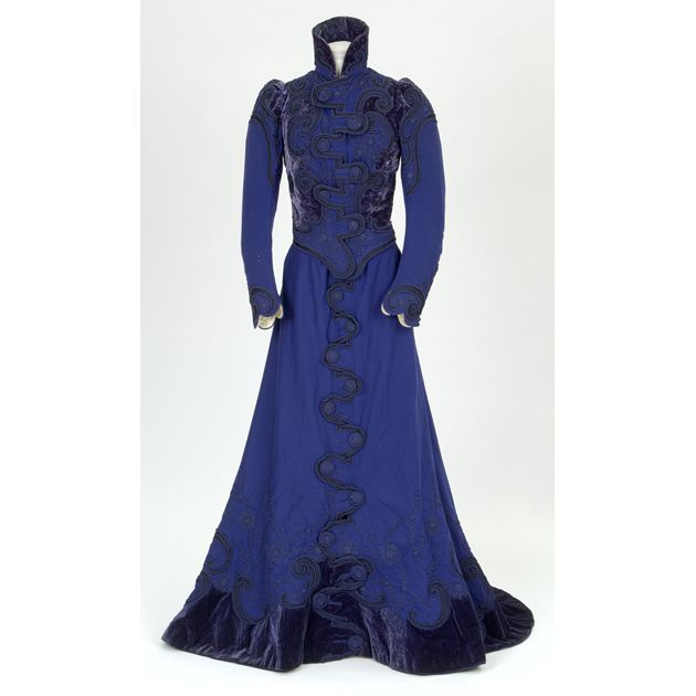 1899 Two-piece walking dress in blue wool face-cloth decorated with silk velvet and braid.  Made by Madame Hayward.  Worn as a going-away dress by Elizabeth Holms-Kerr after her wedding.    Glasgow Museums E.1988.104.2