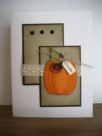 handmade card ... Autumn theme ... luv the graphic feel of the design ... punch art pumpking from ovals ..,. two matted kraft panels ... crochet lace band ... great card ... Stampin' Up!