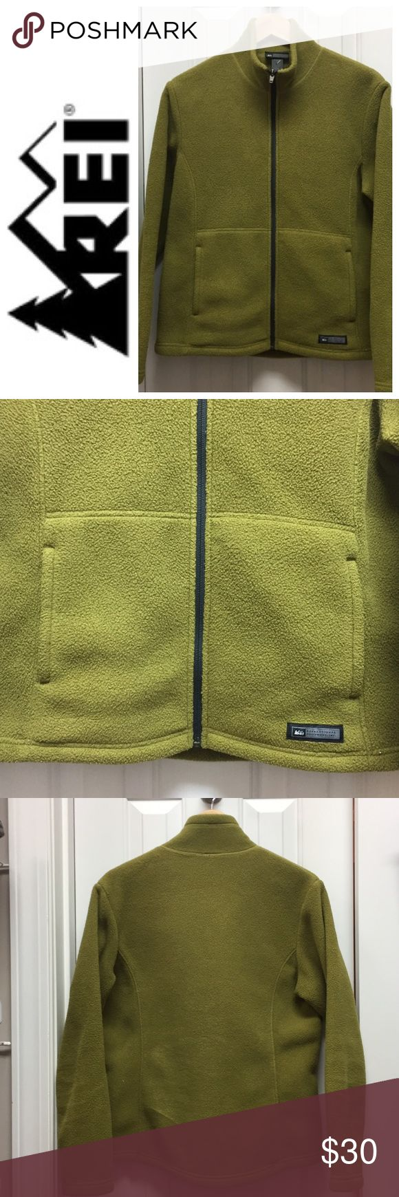 REI Women's Fleece Zip Up Jacket Excellent like new condition. This full Zippered front fleece jacket is mossy green with navy trim. Two front pockets. Size M. Check out my closet and save on bundles . Reasonable offers accepted REI Jackets & Coats