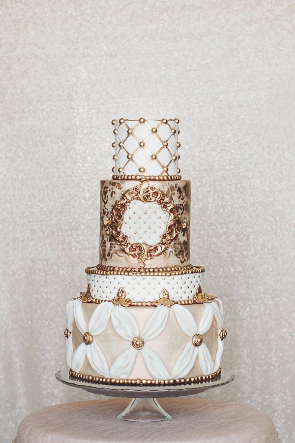 gold and white wedding cake - photo by Hazelwood Photo http://ruffledblog.com/gold-and-lavender-portland-ballroom-editorial