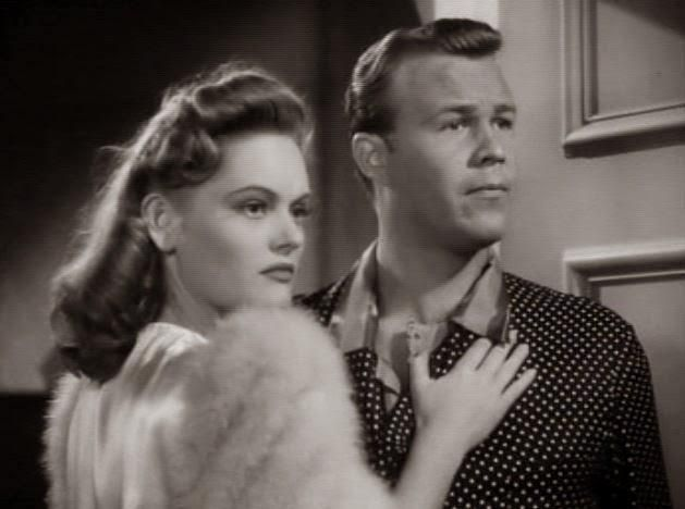 Wayne Morris and Alexis Smith in The Smiling Ghost (1941)