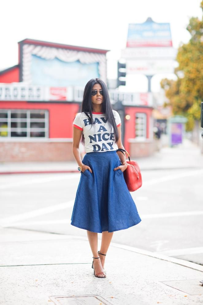 The midi length is having a fashion moment, and what better way to wear it than in denim! Try it out in an A-line or circle cut. Sheryl of Walk in Wonderland pairs her denim midi skirt with a fun graphic tee for a lively summer look.