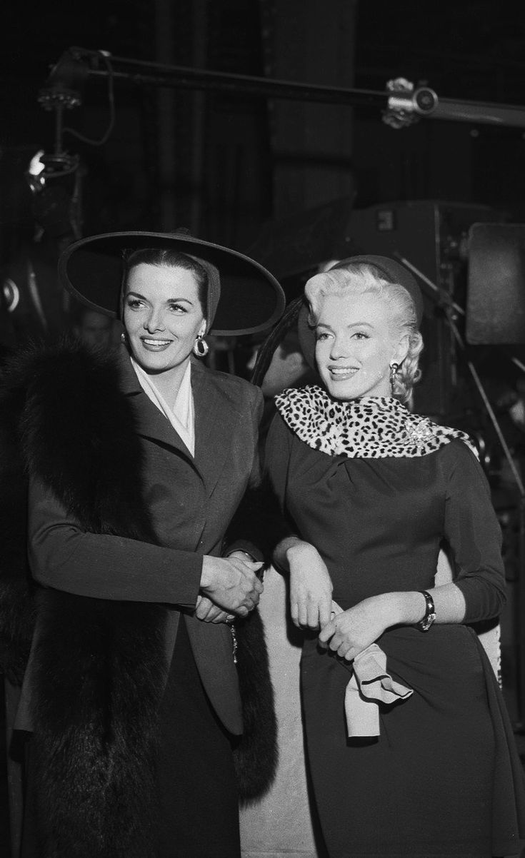 "Marilyn Monroe and Jane Russell take a break on the set of ""Gentlemen Prefer Blondes"" in 1952 (photo by Ed Clark)"