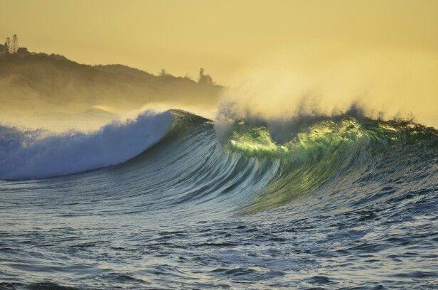 A wave at sunrise